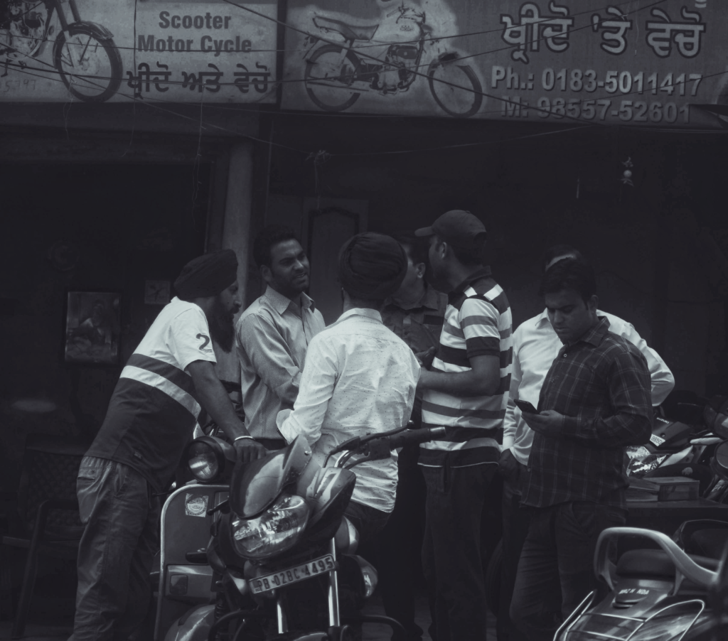 People standing in a group and talking in Amritsar City