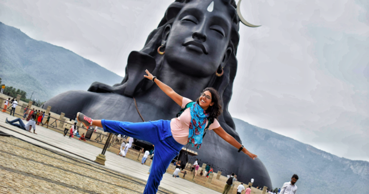 Ajita posing in front of Adiyogi statue at Isha Yoga Center in Coimbatore