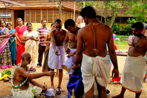Priests dressing the idol in Mulakkal temple